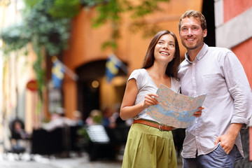 Stockholm tourists couple with map in Gamla Stan