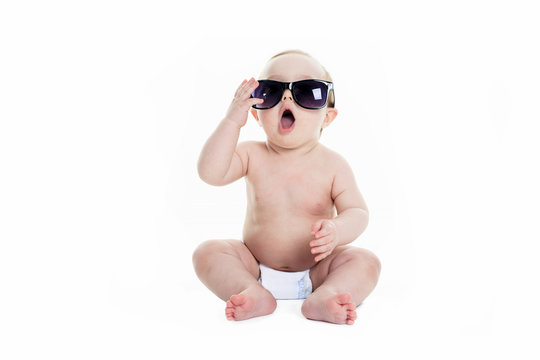 Portrait of cute toddler wearing sunglasses. Isolated on white.