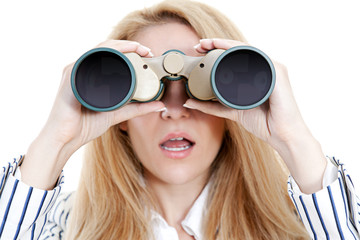 Surprised girl using binoculars