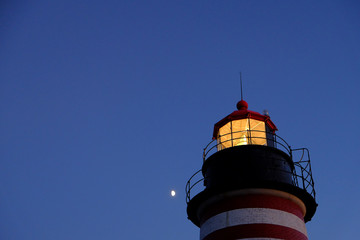 Dusk early evening with moon on the Quoddy Light