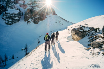 Dolomiti - hikers with snowshoes Wall mural