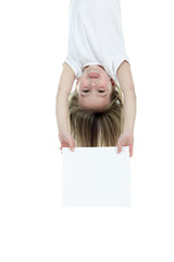 A children girl holding a white card over a white background.