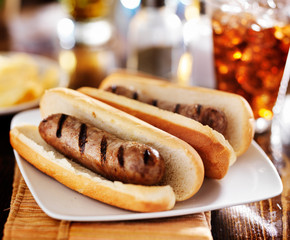 bratwursts that were grilled with cola and potato chips