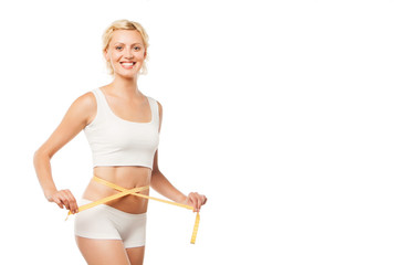 Happy smiling woman with a measuring tape over white