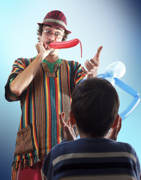 Balloon twister entertaining child in his birthday party.