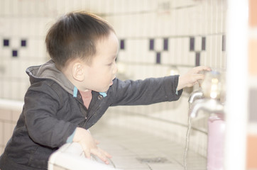 Smart kid washing hands