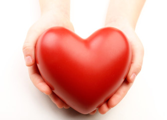 Heart in child hands isolated on white