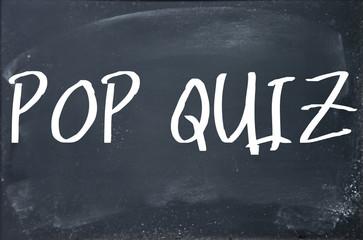 pop quiz text write on blackboard