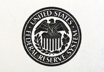Macro shot of United States Federal Reserve System symbol on old