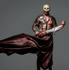 Tattooed medievel fighter in skull mask
