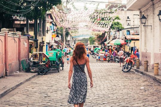 Young woman walking in Manila