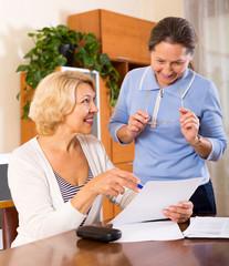 senior ladies signing documents