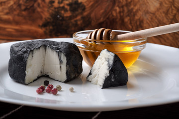 delicious goat cheese covered with black ash and honey