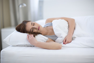 Beautiful woman sleeping on the bed at home