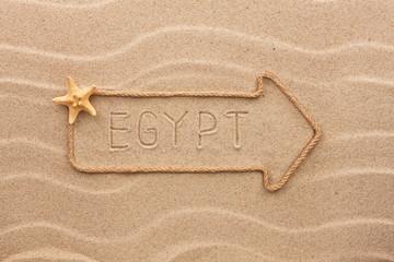Arrow made of rope and sea shells with the word Egypt  on the sa