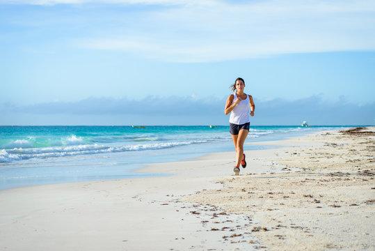 Woman running at tropical beach