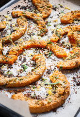 Grilled pumpkin slices with herbs. Selective focus