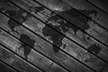 World map on the background of black wood boards.