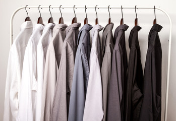 Several shirts on a hanger.