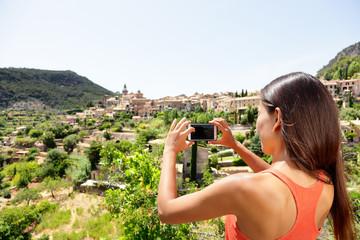 Tourist taking picture of Deia Village in Mallorca