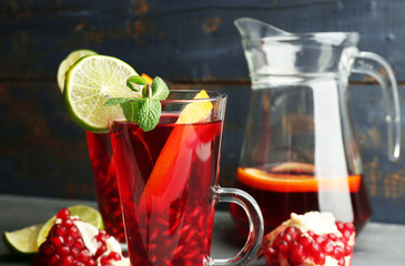 Pomegranate drink in glasses with mint and slices of orange and