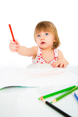 Little baby girl draws pencil