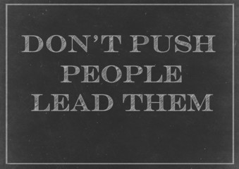 Chalkboard with Don't Push People, Lead Them message  Hand Drawn