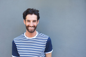 Cool young man smiling in striped shirt