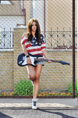 Fashion portrait of attractive young woman with guitar