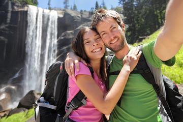 Hikers couple taking selfie at Yosemite waterfall
