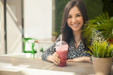 Happy girl with a smoothie