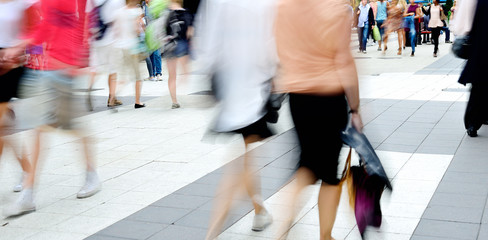 Motion blurred pedestrians on shopping street