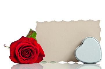 Red rose with  box in the shape of a heart and blank gift card f