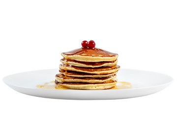 Pancakes with honey and cranberries on a plate. Isolated