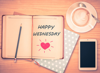 Happy Wednesday on notebook , pencil, smart phone and coffee cup