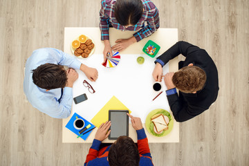 Top view table with creative people