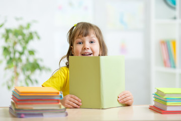 kid girl with open book