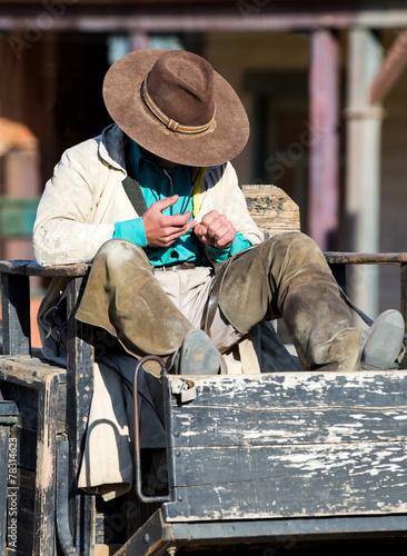 Wall mural Cowboy sitting on a wagon at Mini Hollywood Almeria Spain