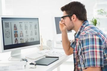 Focused businessman using computer monitor