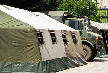 Military tent and truck