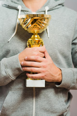 man raising his trophy