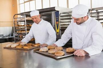 Bakers checking freshly baked bread