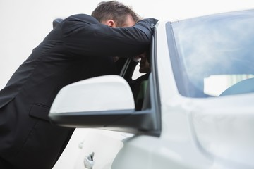Businessman looking inside the car