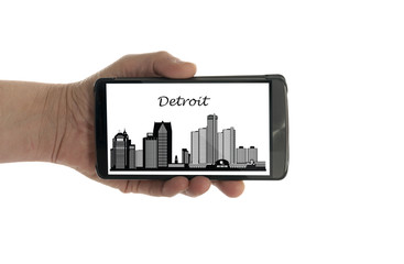 female hand with mobile phone Detroit skyline