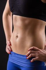 Sporty Female Sweaty Abdomen on Black Background