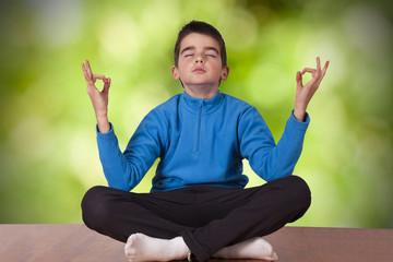 child meditating yoga