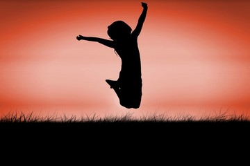 Silhouette of little girl jumping
