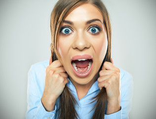 funny face of young business woman . open mouth. teeth.