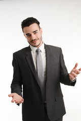 isolated young business man positive attitude with his hands