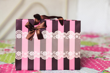 magenta colored stripes paper bag with laces